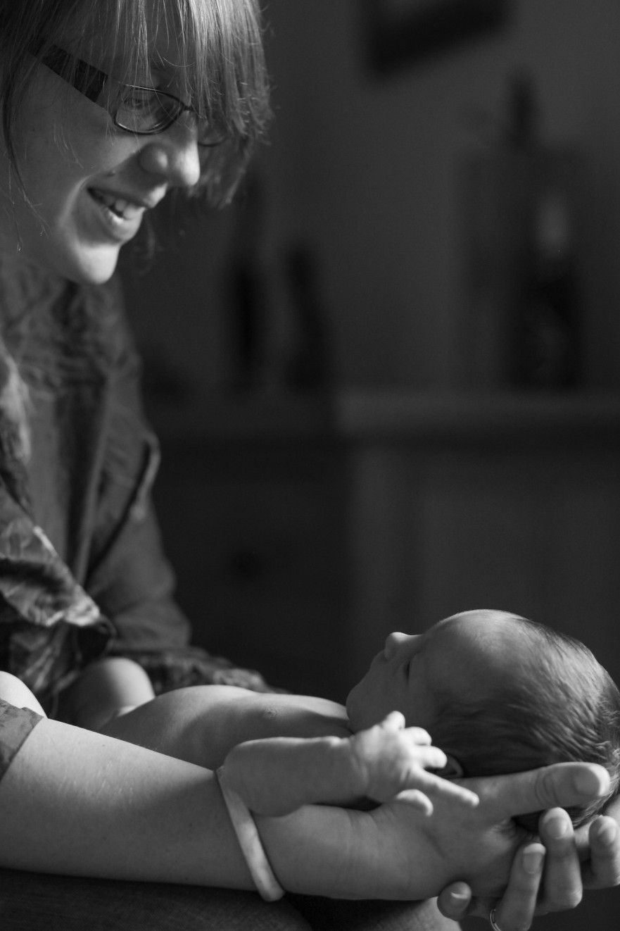 A family welcomes their newborn baby; newborn baby portrait photographer London London Children Photography